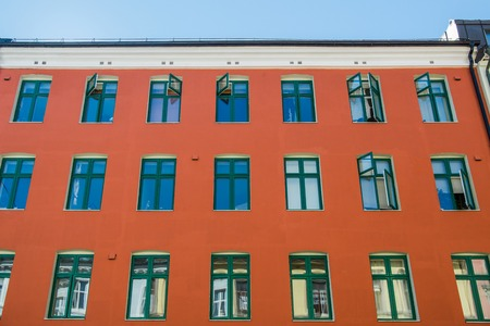 low angle view of bright red house at sunny day in oslo, norway Reklamní fotografie