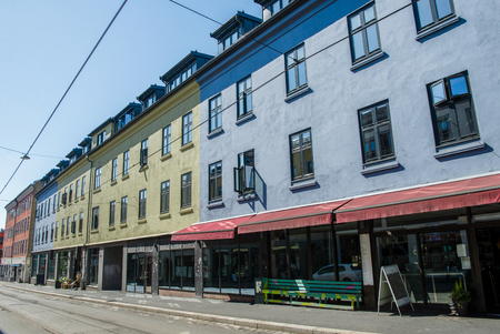 beautiful bright buildings and empty street at sunny day, oslo, norway Banco de Imagens