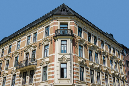 low angle view of beautiful old building with balconies and decorative elements against blue sky, oslo, norway 스톡 콘텐츠