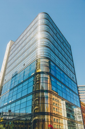 low angle view of modern office building against blue sky, oslo, norway