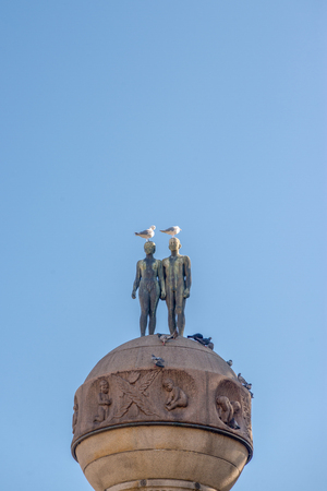 low angle view of birds on naked couple statue outside Central Railway Station, Oslo, Norway Stock Photo