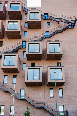 low angle view of modern architecture with stairs, windows and balconies at Barcode district, Oslo