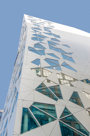 low angle view of contemporary white geometric building against blue sky, Barcode district, Oslo Reklamní fotografie