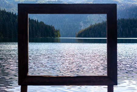 view through frame on beautiful glacial Black Lake in Montenegro Reklamní fotografie