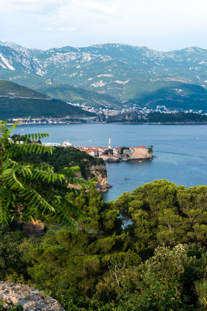 beautiful view of green trees, adriatic sea and old town of Budva in Montenegro