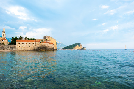 Bell Tower of Sveti Ivana Cathedral and Adriatic sea in Budva, Montenegro Stock Photo