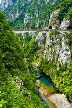 bridge between mountains above beautiful Piva River in Piva Canyon in Montenegro