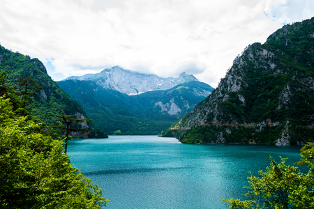 landscape of beautiful Piva Lake, mountains and clouds in Montenegro