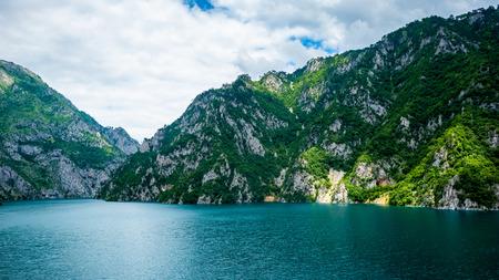 Piva Lake (Pivsko Jezero) and mountains with sunlight in Montenegro Stock Photo