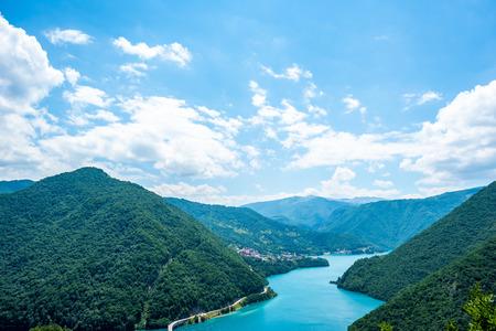 aerial view of beautiful Piva Lake (Pivsko Jezero) and mountains in Montenegro