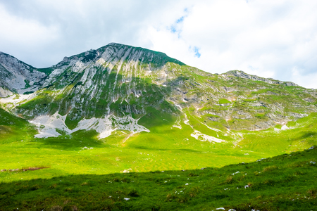 beautiful green valley with sunlight in Durmitor massif, Montenegro