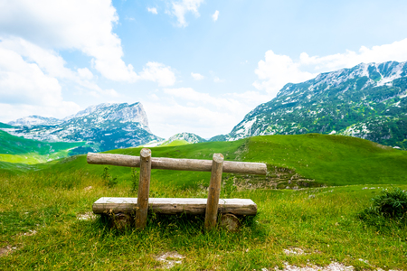 wooden bench with beautiful mountains in Durmitor massif, Montenegro
