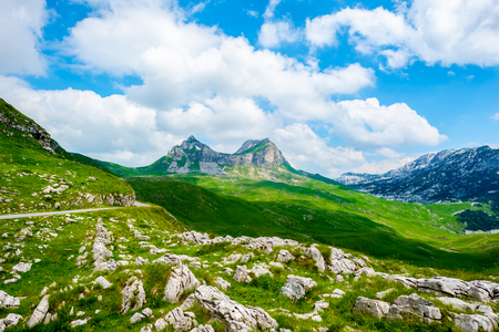 rocky mountains and blue cloudy sky in Durmitor massif, Montenegro