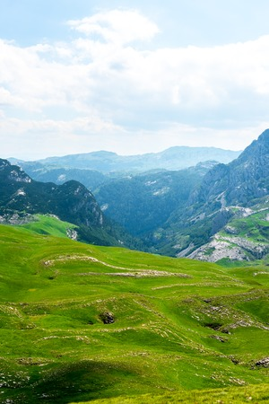 landscape of green valley and mountains in Durmitor massif, Montenegro Stock Photo