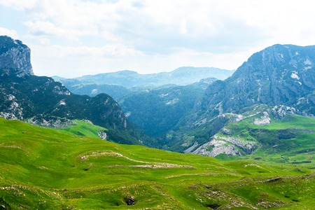 beautiful green valley and mountains in Durmitor massif, Montenegro