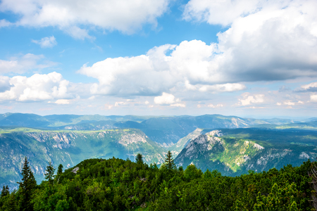 cloudy blue sky above mountains in Durmitor massif, Montenegro Фото со стока