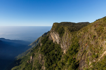 beautiful scenic view of mountains covered with green plants and clear blue sky, sri lanka, horton plains