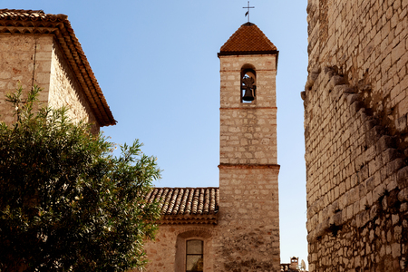 ancient church with bell tower at old european town, Antibes, France