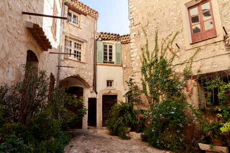 facades of ancient stone buildings at old european town, Antibes, France Reklamní fotografie - 109552959