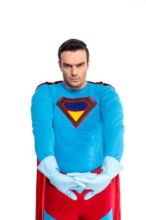 handsome superhero in rubber gloves looking at camera isolated on white Imagens