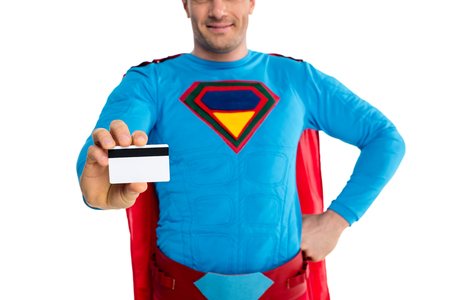 cropped shot of smiling male superhero holding credit card isolated on white Banco de Imagens - 109557977