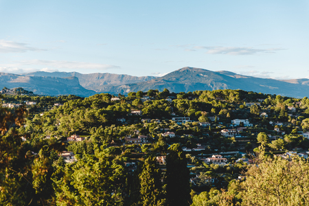 aerial view of beautiful european town in mountains on sunset, Cannes, France