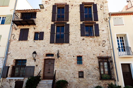 facade of ancient luxury building at old town, Antibes, France
