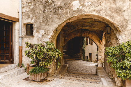 arch and ancient grungy buildings at old town, Sainte Agnes, France