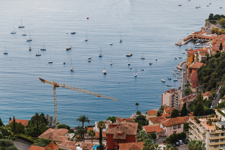 aerial view of old european city located on seashore with lot of ships, Eze, France 写真素材