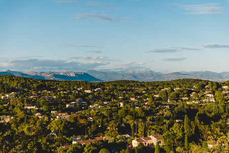 aerial view of european town in mountains on sunset, Cannes, France Banco de Imagens