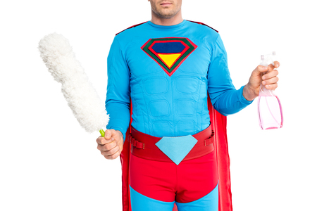 cropped shot of man in superhero costume holding duster and spray bottle isolated on white