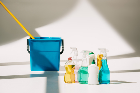 various cleaning products, mop and bucket on white Reklamní fotografie