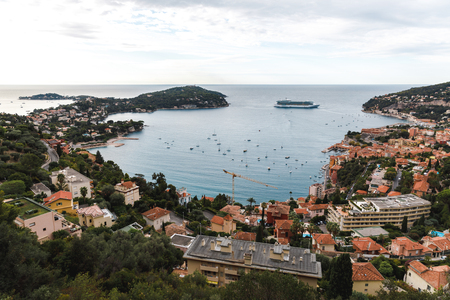 aerial view of european city located on seashore with lot of ships and peninsula, Eze, France