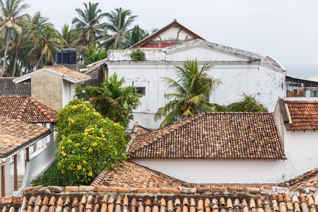 scenic view of buildings and trees with green foliage, sri lanka, galle fort