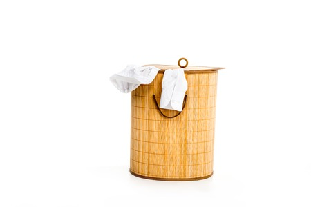 wicker laundry basket with clothes isolated on white Banco de Imagens