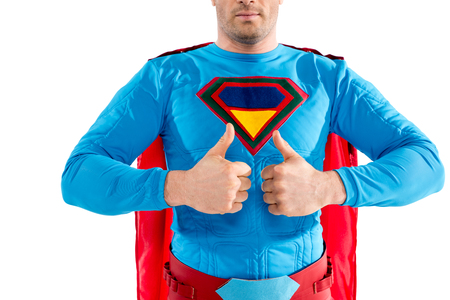cropped shot of confident superhero showing thumbs up isolated on white