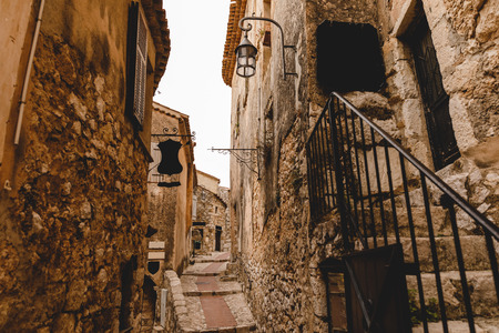 narrow street with ancient buildings at old town, Eze, France 版權商用圖片