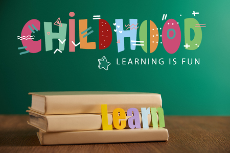 books with learn sign, chalkboard on background with childhood - lettering in fun lettering