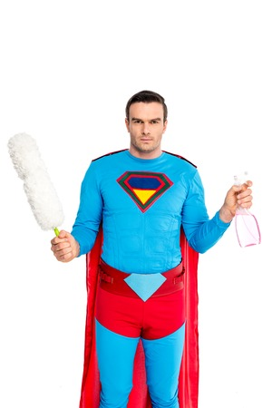 man in superhero costume holding duster and spray bottle isolated on white Banco de Imagens