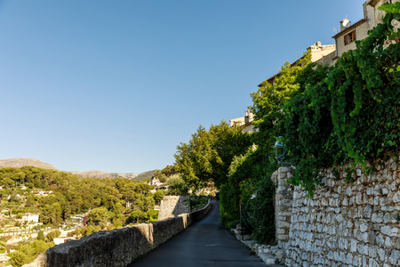 hill road with sides covered with vine at old european town, Antibes, France