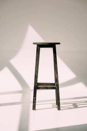 single empty tall wooden stool on white Standard-Bild - 109553822