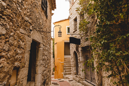 ancient stone buildings on narrow street of old town, Eze, France 版權商用圖片