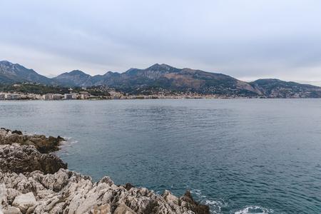 rocky coast of beautiful city located on seashore, Menton, France Banco de Imagens
