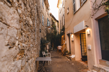 narrow street with small restaurant at old town, Cannes, France