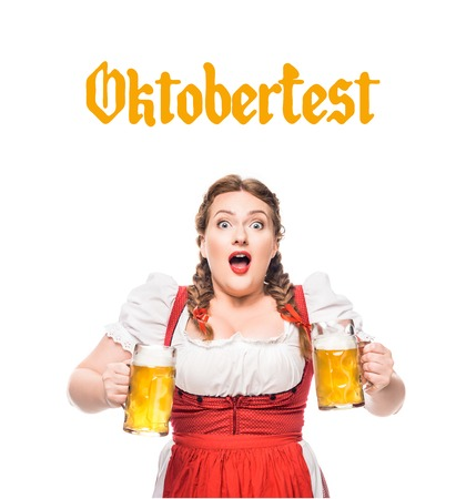 shocked waitress in traditional bavarian dress with mugs of light beer isolated on white background with oktoberfest lettering