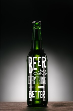 bottle of beer on dark grey background with beer makes everything better inspiration