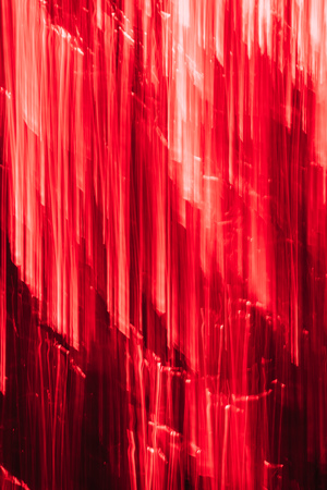 beautiful red vertical illuminated stripes, abstract background