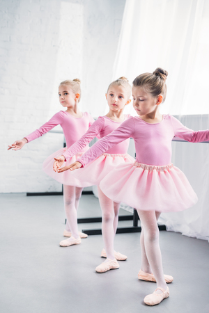 adorable little ballerinas practicing together in ballet studio