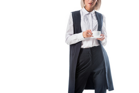 partial view of businesswoman with cup of coffee isolated on white