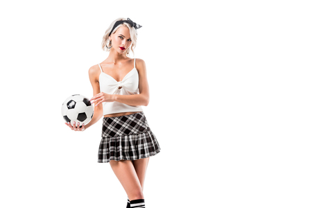 portrait of seductive woman in plaid schoolgirl skirt with football ball isolated on white